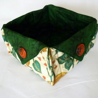 folded fabric storage tub for your bits and bobs, leaf print fabric, green