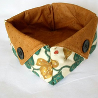 folded fabric storage tub for your bits and bobs, leaf print fabric, tan