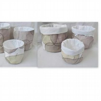 set of three graduated grey apple cotton storage tubs for your nik naks
