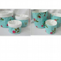 set of three graduated turquoise rose cotton storage tubs for your nik naks
