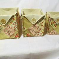 set of three graduated folded fabric storage tubs for your nik naks, beige