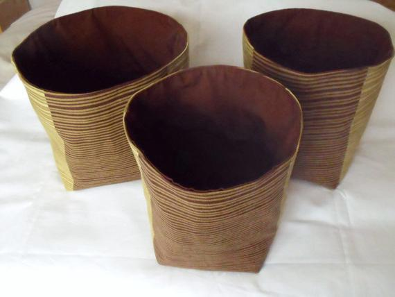 set of three graduated pistachio and brown cotton storage tubs for your nik nak