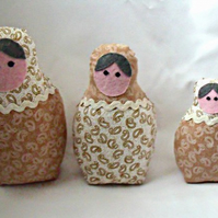 beige graduated russian matryoshka nesting display art dolls