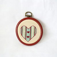 small embroidered heart art wall hanging, just under 3 inches