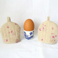pair of beige floral quilted egg cup cozies, easter gift