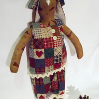 Tilda style tan primitive bunny rabbit doll for display, faux patchwork outfit
