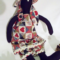 Tilda style navy bunny rabbit doll for display, faux patchwork outfit