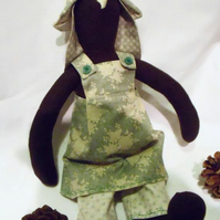 Tilda style brown bunny rabbit doll for display, green floral outfit