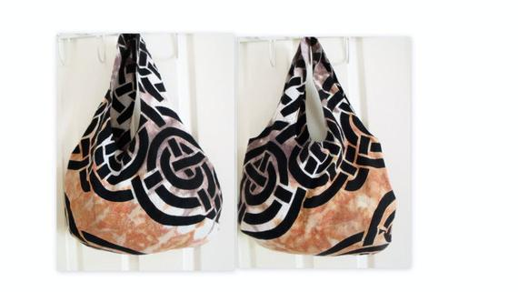 celtic cotton reversible lightweight boho shoulder bag, orange, black