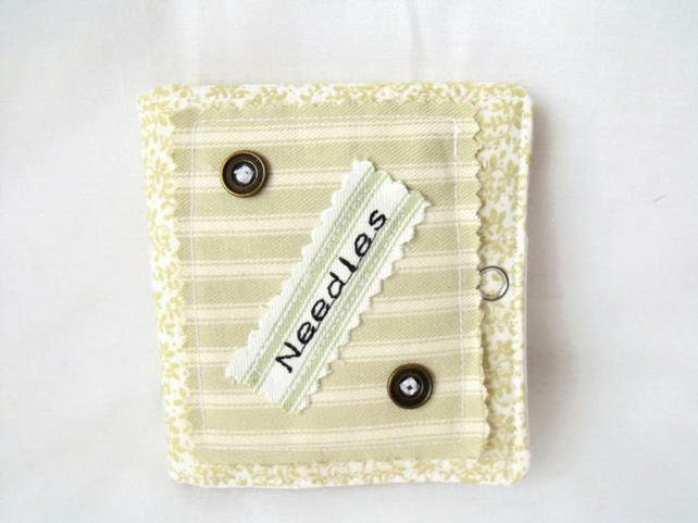 sewing needle keep safe book, pale green with brass buttons