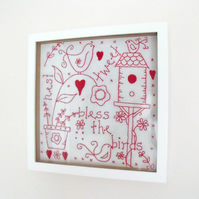 framed red work embroidered birds wall hanging