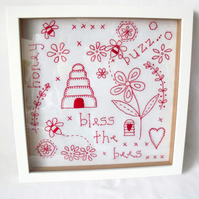 framed red work embroidered bees wall hanging