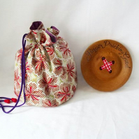 green and burgundy floral drawstring make up pouch or small project bag