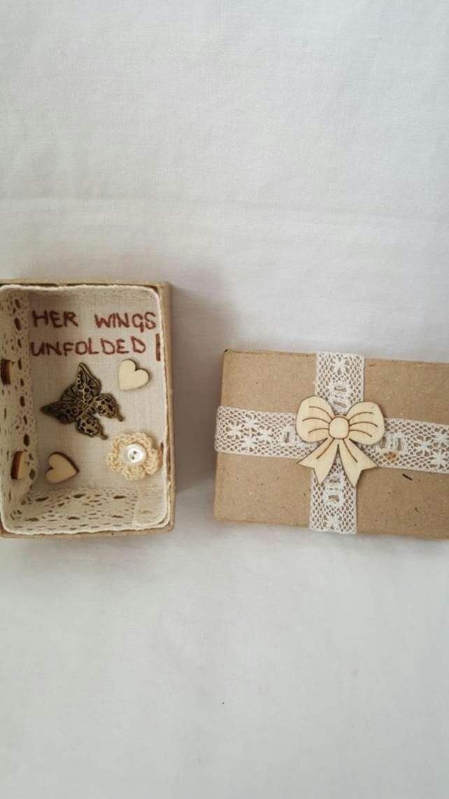 small miniature art diorama with a message 'her wings unfolded'