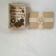 small miniature art diorama with a message 'just like a butterfly'