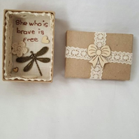small miniature art diorama with a message 'she who is brave is free'