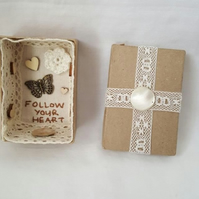 small miniature art diorama with a message to 'follow your heart'