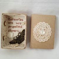small miniature art diorama with a message 'butterflies are self propelled......