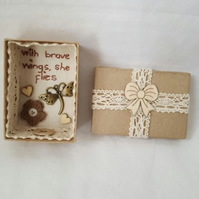 small miniature art diorama with a message 'with brave wings she flies'
