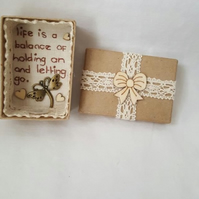 small miniature art diorama with a message 'life is a balance...................