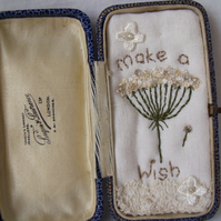 small miniature art diorama with a message 'make a wish' in a vintage box