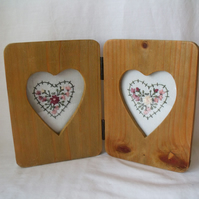 two heart embroideries in a rustic double heart picture frame