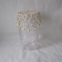 vintage style crocheted beaded doily jug cover to repel bugs when outdoors