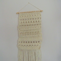 wool blend crocheted sampler wall hanging with tassels