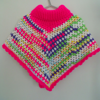 girls crocheted roll neck poncho in bright pink and multicoloured yarn, 8-10y