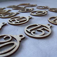 laser cut wooden christmas advent numbers in the shape of baubles