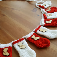 festive crocheted christmas stocking garland, red and white sparkly