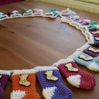 festive crocheted christmas stocking garland, multicoloured