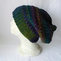 green crocheted slouchie beanie hat with criss cross stitches