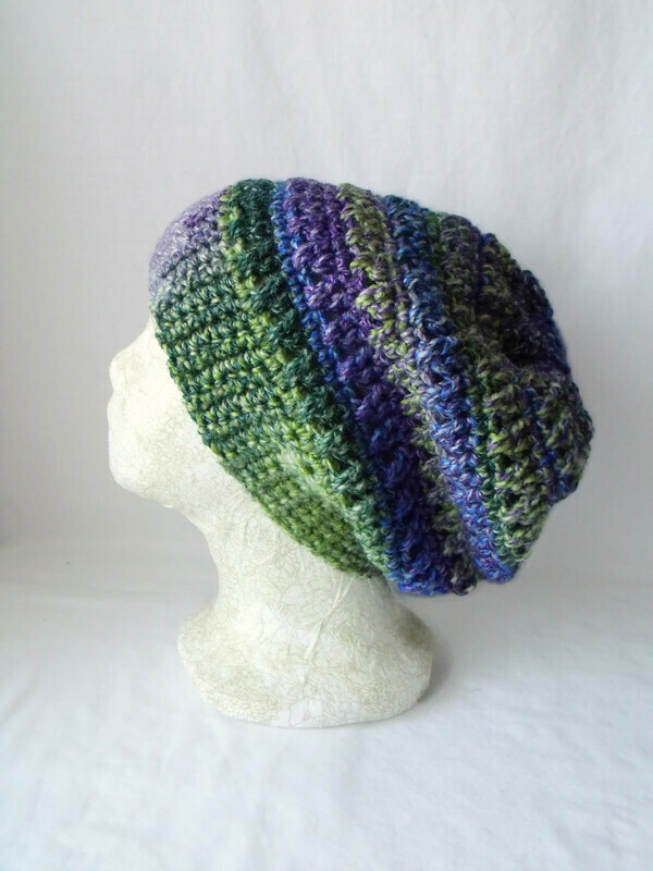 green and purple crocheted slouchie beanie hat with criss cross stitches