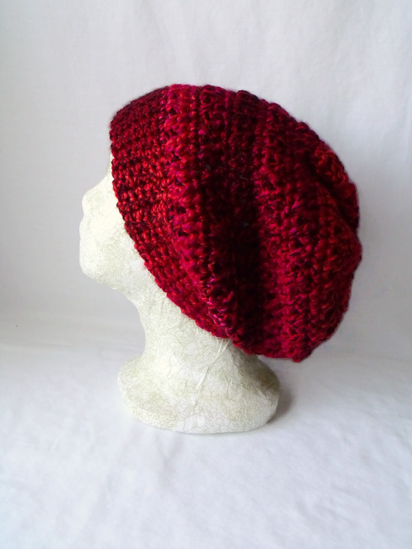 red crocheted slouchie beanie hat with criss cross stitches