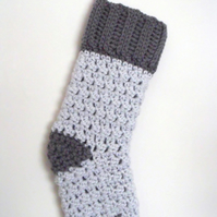crocheted christmas stocking in grey