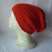 burnt orange coloured crocheted ladies slouch beanie hat