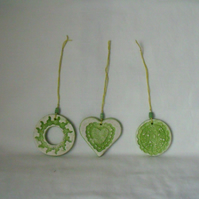 set of three impressed ceramic hanging decorations in green