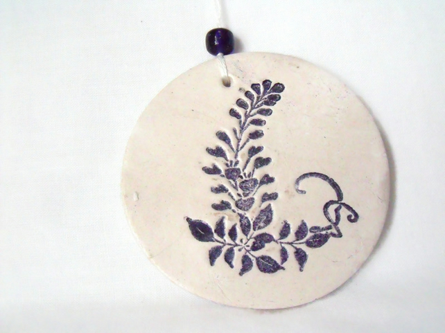 ceramic floral hanging decoration in black and white