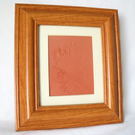 impressed terracotta tile in a box frame, daffodil design, 8 x 9 inches