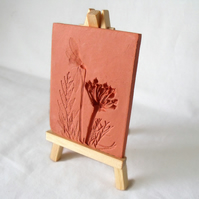 terracotta impressed clay tile displayed on an easel, number 5 of 8 available
