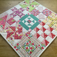 Sampler patchwork table topper