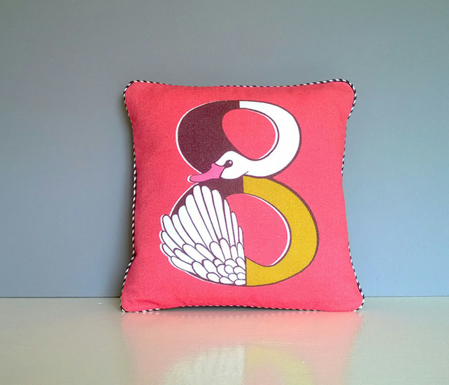 Children's cushion in retro style with a number print of a swan