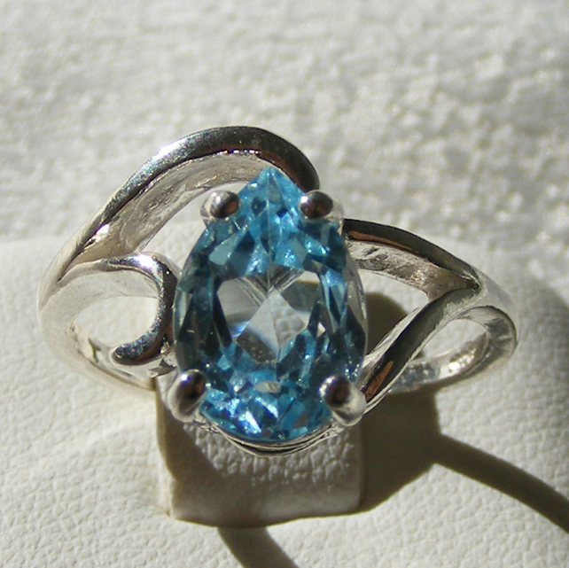 Ring in Sterling Silver featuring a Lovely Blue Topaz & Swirl Design