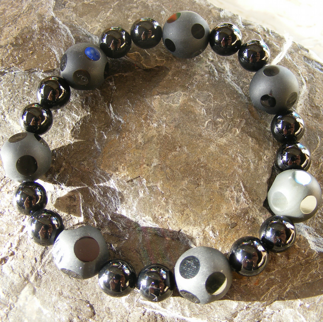 Stretch Bracelet with Unusual Faceted and Highly Polished Black Onyx