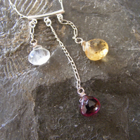 Necklace in Sterling silver featuring stunning garnet, moonstone & citrine drops