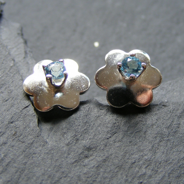Stud Earrings in Sterling Silver in a Daffodil Design set with Blue Topaz Gems