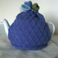Hand knitted lavender tea cosie with crocus flowers