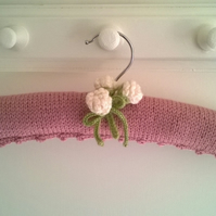 Hand knitted padded girls rosebud clothes hanger