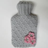 Knitted trellis and daisy hot water bottle